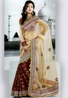 Cream and maroon net and viscose jacquard saree beautifully embellished with resham, zari, stone and patch border work.  As shown maroon viscose jacquard blouse can be made available which can be customized upto 44 inches, as per your style or pattern subject to fabric limitation. (Slight variation in brocade design, embroidery color and patch border work is possible.). data-pin-do=
