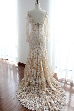 WHAT A STUNNER!  Long lace sleeves wedding gown in Ivory and Nude color with sheer neckline. The luxury lace pattern makes it exquisite, and