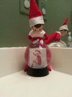 Gazing into Santa's ball at his Sweetheart back at the North Pole.