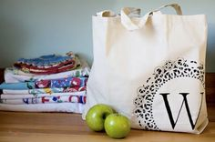 monogrammed canvas bag using paint and a doily.
