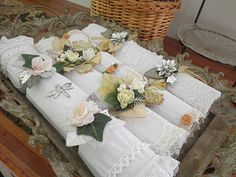 Handmade Christmas crackers in white with vintage lace trims