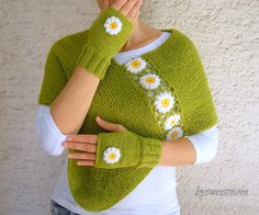 This hand knitted green fingerless gloves are embellished with white crochet…