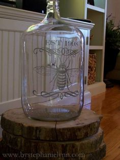 i love this idea!  i have spare wine jugs and was wondering what to do with them.  problem solved! http://www.bystephanielynn.com/2011/01/large-glass-carboy-water-jug-find-how-to-apply-cut-vinyl-to-glass.html