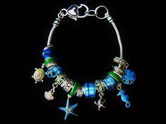 jewelry, bracelet, silver, blue, aquamarine, topaz, starfish, shells, turtle, seahorse, sea life, flowers, beads, charms, charm bracelet Visit: www.gladisparkle.com