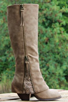 Our $100 Southern Sass Riding Boots are ADORABLE! They are a synthetic leather on the exterior with a super soft microfiber interior and double zippers. They feature detailing throughout with a 'fold over' design near the ankle with lace detailing at edge of