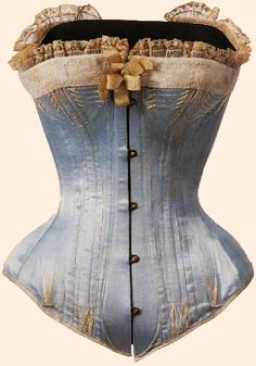 Corset France During the Bustle period, undergarments became more risque and colorful. This corset was made from blue silk satin, steel busk, and bone. The busk and bones mold the curve from the waist to the abdomen. Corset Vintage, Victorian Corset, Vintage Lingerie, Victorian Era, Victorian Fashion, Vintage Fashion, Edwardian Style, 1880s Fashion, Vintage Underwear