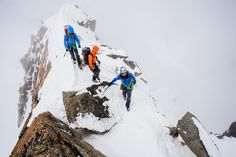 Two participants and their British Mountain Guide walk on the narrow ridge of Arête à Laurence. It was great to see that despite the wintery conditions, with wind and snow during most of the day, the stoke was high for everybody!  Photo: Hugo Vincent