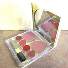 Estee Lauder Deluxe Palette for Lips and Cheeks with Blush All Day in Desert and Plum and Pure Color Long Lasting Lipstick in Rose Tea, Candy, Red Lacquer, and Tiger Eye. With Blush All Day Natural CheekColor in Desert and Plum. With Pure Color Long Lasting Lipstick in Rose Tea, Candy, Red Lacquer, and Tiger Eye. All in a gorgeous compact.