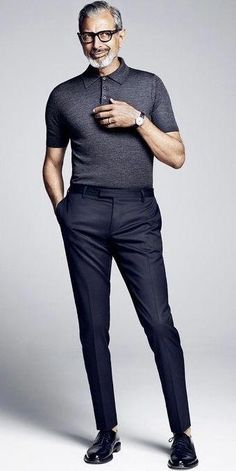 Jeff Goldblum with a summer outfit idea with a gray polo shirt black leather banded watch black trousers no show socks black shoes. Polo Shirt Outfits, Grey Polo Shirt, Stylish Mens Outfits, Casual Outfits, Business Casual Men, Men Casual, Business Dress, Moda Formal, Le Polo