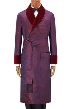 This exquisite gown in a lustrous silk navy and red satin paisley design is entirely handmade in England, using silk woven in Suffolk. It features hand quilted velvet revers and gauntlet cuffs. It has two patch pockets and a breast pocket and is fully lined throughout in burgundy satin. The gown is piped throughout in navy satin.