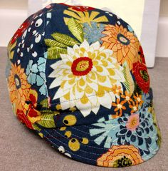 simply a floral cotton cycling cap for adults or kids. $25.00, via Etsy.
