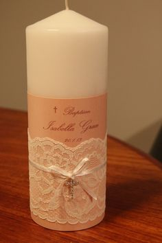 make your own christening candle with some scrapbooking papers, lace and embellishments.