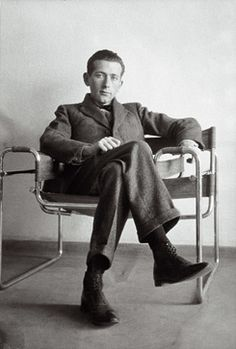 Marcel Breuer, in his famous Wassily tubular steel chair.