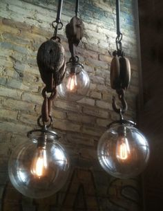 Upcycled pulley pendant lamps -- nice!
