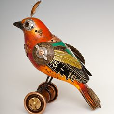 'Colorful Bird on Wheels' #BD76 by Florida-based Jim Mullan of Mullanium. Handcrafted from found objects. So very engaging! 5 1/2 H X 5 1/4 L. via Mullanium by Jim and Tori