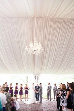 Add drama to your space with canopy fabric and a chandelier   Studio 220 Photography