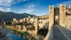 View of the historic site of Besalú, a fortified medieval village with access throught his renown Romanesque bridge shown in the foreground, Catalonia, Spain Barcelona Tours, Girona Spain, Spanish Towns, Le Village, Beaux Villages, Spain And Portugal, Wallpaper Desktop, Day Trip, Places To Go