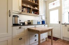 Bespoke solid oak pullout table in Victorian kitchen - Sheffield Sustainable…