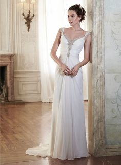 This sophisticated Elysium chiffon sheath dress is sweetened with glittering Swarovski crystals trailing the neckline and scalloped back. Complete with Swarovski crystal edged cap-sleeves. Finished with crystal button over zipper closure. #weddingdresses #weddinggown #wedding #dresses #gown #bridal #love