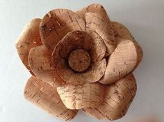 Hometalk :: Cork Ribbon Flowers  Dont get real excited, the flower is not made of cork, but ribbon to that looks like cork.  Still cool.  Think it woud be great with flowers made out of a book about wine.