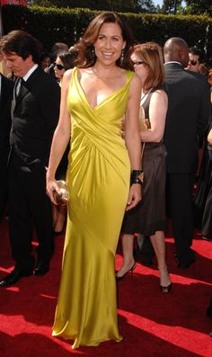 Minnie Driver's silky yellow Donna Karan in 2007 was just the right color and silhouette. Cool contrasting black cuff too. // Memorable Gowns From the Emmys Minnie Driver, The Emmys, Red Carpet Gowns, Donna Karan, Yellow Dress, Photo Galleries, Awards, How To Memorize Things, Silhouette