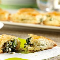 Feta cheese and spinach are wrapped in flaky puff pastry in this tasty appetizer. Good thing they're easy to make, because they're sure to disappear fast.
