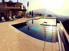Amazing view dawn with your infinty pool, by Piscinas Godo. http://piscinasgodo.com/proyectos/proyecto-bisazza-cobalto/