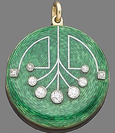 An enamel and diamond locket\/pendant circa 1910 The circular plaque decorated with green guilloché enamel highlighted with old brilliant and single-cut diamonds inscribed to the reverse \My husband Xmas 1911\ diamonds approx. 0.55ct. total length 4.0cm.