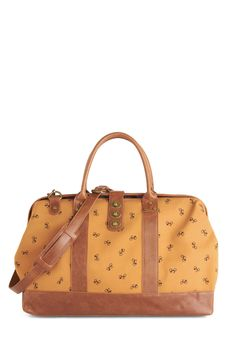 The Scenic Commute Weekend Bag in Bike Ride. Bask in the delightful scenery of this charming weekend bag! #tan #modcloth