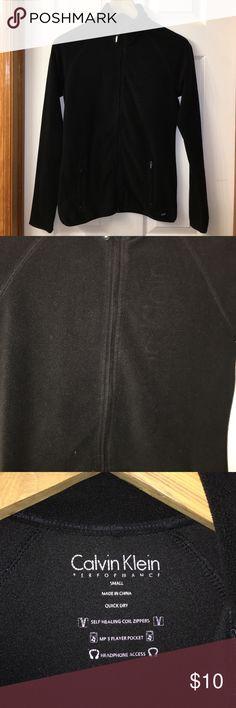Calvin Klein Performance Zip Fleece Jacket Black fleece jacket with iPhone/MP3 pocket.  Thumb holes in sleeves and two zip pockets.  All zippers work, no holes or tears. Calvin Klein Jackets & Coats