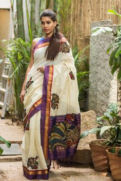 A beautifully Kalamkari worked creation! In a Gadwal cotton kota with a pure silk border and pallu, appliquéd with Kalamkari motifs and zari work. This would be a lovely saree to own in a true Kalamkari tradition.Pair with any color in the border or Kalamkari work and you'll be all set! This saree can be paired in many interesting ways with textural and intricately worked blouses too. #kalamkari #saree #india #blouse #houseofblouse