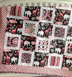 This modern baby girl quilt features Michael Miller fabrics with playful jungle animals in pink, grey and white prints. The backing and