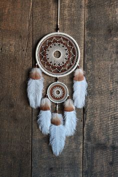 White cream color dream catcher. This is my authors dreamcatcher. Decorated with beautiful ostrich and turkey feathers.The dense woven web inside the hoop repeats the color of feathers. It makes the dream catcher harmonious.  Only natural materials are used: metal hoops, cotton thread, wooden beads, ostrich and turkey feathers. This dreamcatcher may be eco design your home, and also an excellent gift for family members or friends.  Size: diameter of the hoop 7,5(19cm) length of dreamcatcher…
