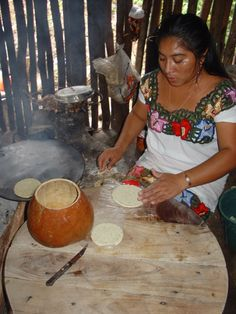 Maya woman baking bread