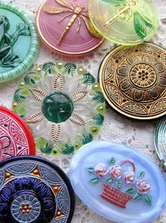 Art Glass Buttons. Another beautiful thing my talented sister Mary introduced me to. She made darling sewing heart pockets using reproduction antique glass buttons.