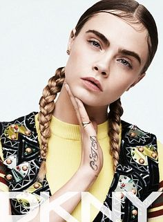 Cara also stars in the womenswear campaign and rocks pigtails and wispy hair gelled to her face