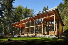 The Seattle Times: Island cabin offers a place to go outside and play. Windows, screened in porch, prefab and green built! Cabin Design, Cottage Design, Tiny House Design, Prefab Homes, Cabin Homes, Log Homes, Cabins In The Woods, House In The Woods, Passive Solar Homes