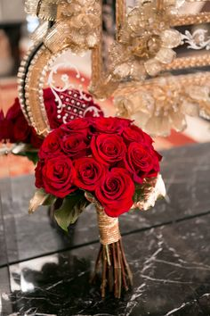 Romantic red roses, tied with a gold thread. #wedding #bouquet