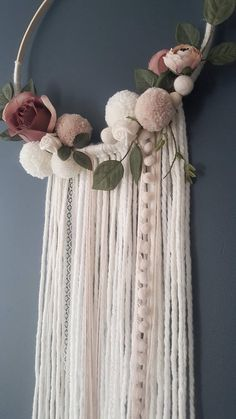 Boho Dreamcatcher - Custom To Order Make your wall beautiful with this soft and boho dreamcatcher! Perfect for any room! The base is a natural wood hoop made of artificial flowers and pom poms. The extensions are a variety of chunky wool, pompom trim and lace. Size guide: Approximately 35cm/13inch diameter hoop Please do not hesitate to contact me if you would like further options with regards to colour and I will work with you to create your perfect wall decor. NB. This item is for...