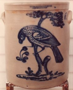 Harrington, Burger 6 gal crock with a highly detailed bird on a tree branch possibly eating fruit.