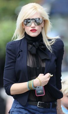 Gwen Stefani dresses up a pair of jeans with a tailored jacket.