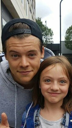Harry with a little girl in London today (Aug 2nd) via karl_bradley