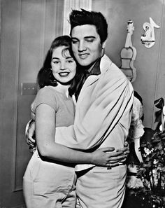 Elvis Presley hugging Kathy Gabriel (who was Miss Ohio at the 'Miss USA' contest) in Graceland, December 27, 1957.