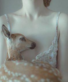 self-portrait with little deer, Kraków, 2015   by Laura Makabresku