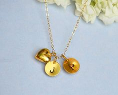 2 Gold initials 24K Vermeil Gold heart on 14K Gold Filled necklace - Love Necklace- Freshwater pearl necklace. $35.99, via Etsy.