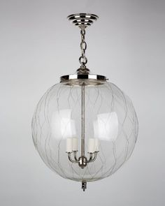 Shown in Polished Nickel but probably not my favorite finish.   Sorenson 18 Lantern HIL2617.18 @ remains.com.  No idea on price