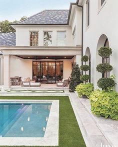 Living A covered patio equipped with RH outdoor furnishings ensures comfortable outdoor living. Outdoor Spaces, Outdoor Living, Outdoor Patios, Outdoor Kitchens, Outdoor Seating, Patio Grande, Big Backyard, Tropical Backyard, Modern Backyard