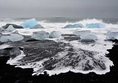 The strikin' contrast of the white water, blue ice n black sand in Iceland