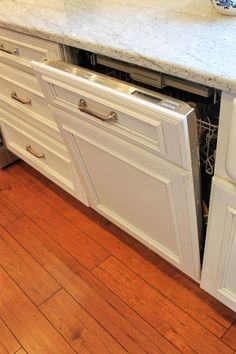 Miele dishwasher with internal water softener with Dura Supreme Cabinetry custom dishwasher panel.