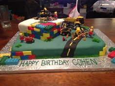 Lego construction cake. Everything on cake is edible (except for trucks) Lego men and blocks are made of chocolate